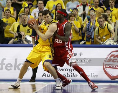 BERLIN - MARCH 31: Blagota Sekulic, #10 of Alba Berlin competes with Kevinn Pinkney, #8 of Hapoel Jerusalem during the Eurocup Quarterfinals Game 2 between Alba Berlin vs Hapoel Jerusalem at O2 World Arena on March 31, 2010 in Berlin, Germany. (Photo by Regina Hoffmann/EB via Getty Images)