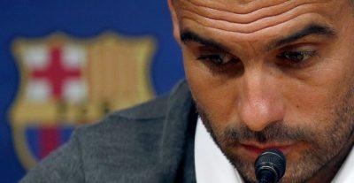 Guardiola-Rp-escudo-fondo-2012-efe