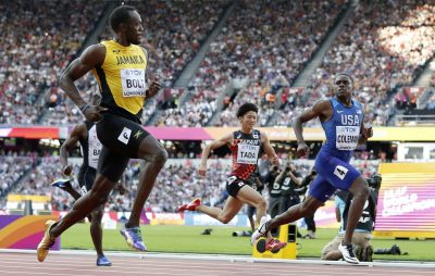 Jamaica's Usain Bolt, Japan's Shuhei Tada and United States' Christian Coleman, from left, cross the line of a men's 100-meter semifinal during the World Athletics Championships in London Saturday, Aug. 5, 2017. (AP Photo/Matt Dunham)