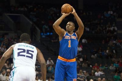 Oct 17, 2015; Charlotte, NC, USA; New York Knicks forward Kevin Seraphin (1) shoots the ball over Charlotte Hornets center Al Jefferson (25) during the first half at Time Warner Cable Arena. Mandatory Credit: Jeremy Brevard-USA TODAY Sports
